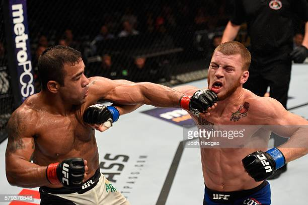 Michel Prazeres of Brazil punches JC Cottrell in their lightweight bout during the UFC Fight Night event at the United Center on July 23 2016 in...