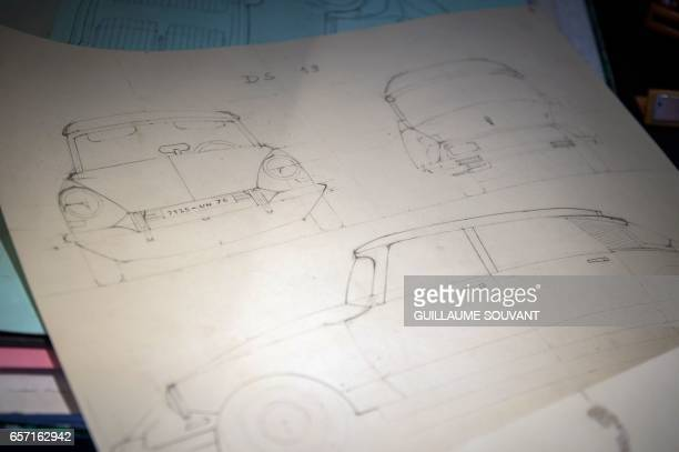 Michel Robillard shows the details plans for the building of a wooden 2CV Citroen Car built as an exact one/one replica on March 20 near Loches...