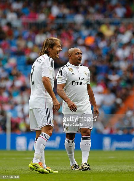 Michel Salgado and Roberto Carlos of Real Madrid Leyendas smile during the Corazon Classic charity match between Real Madrid Leyendas and Liverpool...