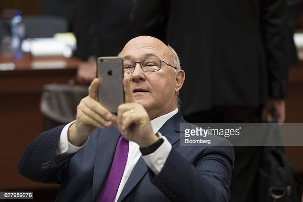 Michel Sapin France's finance minister takes a photo with his Apple Inc smartphone ahead of an Ecofin meeting of European Union finance ministers in...