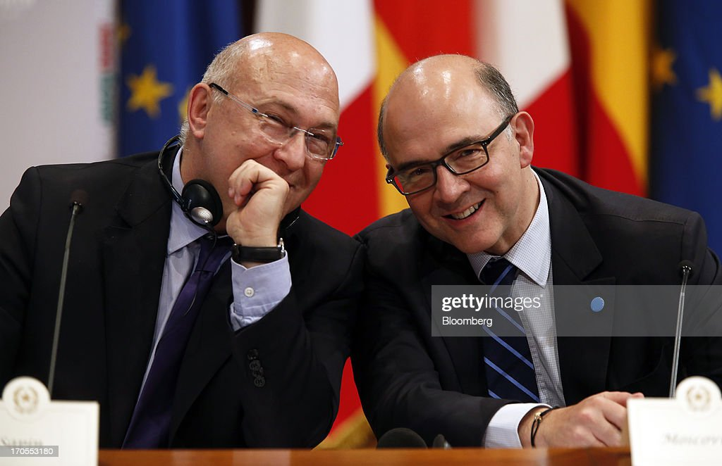 Michel Sapin, France's labor minister, left, and <a gi-track='captionPersonalityLinkClicked' href=/galleries/search?phrase=Pierre+Moscovici&family=editorial&specificpeople=667029 ng-click='$event.stopPropagation()'>Pierre Moscovici</a>, France's finance minister, smile during a news conference following a youth unemployment summit at Chigi palace in Rome, Italy, on Friday, June 14, 2013. The euro-region's unemployment rate climbed to a record 12.2 percent in April, the European Union statistics office in Luxembourg said on May 31. Photographer: Alessia Pierdomenico/Bloomberg via Getty Images