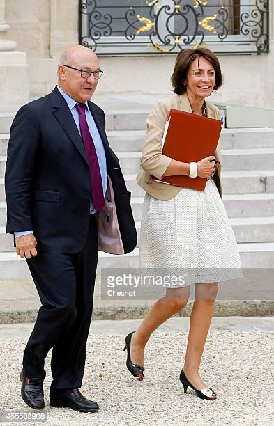 Michel Sapin French Minister of Finance and the Public Accounts and Marisol Touraine French Minister of Social Affairs leave after a weekly cabinet...