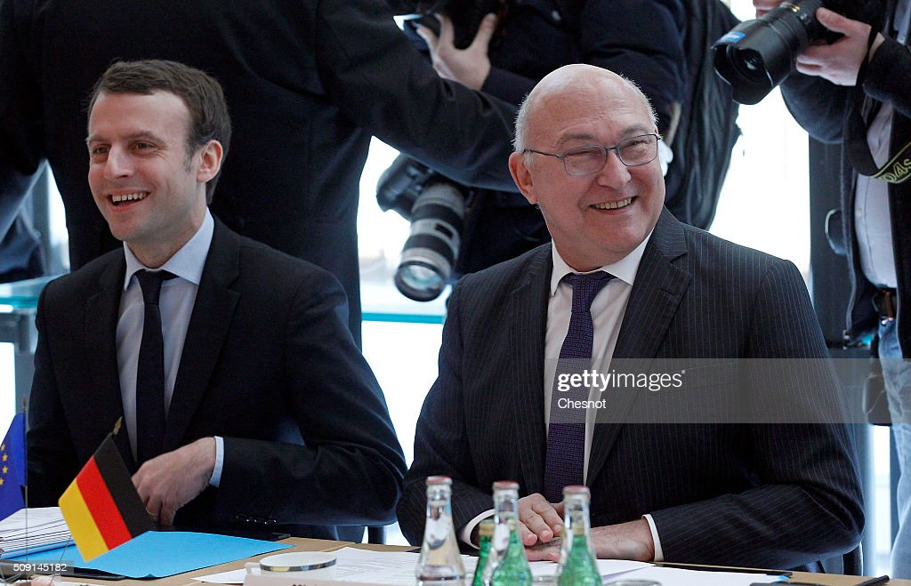 <a gi-track='captionPersonalityLinkClicked' href=/galleries/search?phrase=Michel+Sapin&family=editorial&specificpeople=668944 ng-click='$event.stopPropagation()'>Michel Sapin</a> (R), French Minister of Finance and the Public Accounts and <a gi-track='captionPersonalityLinkClicked' href=/galleries/search?phrase=Emmanuel+Macron&family=editorial&specificpeople=9899223 ng-click='$event.stopPropagation()'>Emmanuel Macron</a>, French Minister of Economy attend a meeting at the French Ministry of Finance on February 9, 2016, in Paris, France. <a gi-track='captionPersonalityLinkClicked' href=/galleries/search?phrase=Michel+Sapin&family=editorial&specificpeople=668944 ng-click='$event.stopPropagation()'>Michel Sapin</a> and <a gi-track='captionPersonalityLinkClicked' href=/galleries/search?phrase=Emmanuel+Macron&family=editorial&specificpeople=9899223 ng-click='$event.stopPropagation()'>Emmanuel Macron</a> meets Wolfgang Schauble for a Franco-German Economic Council