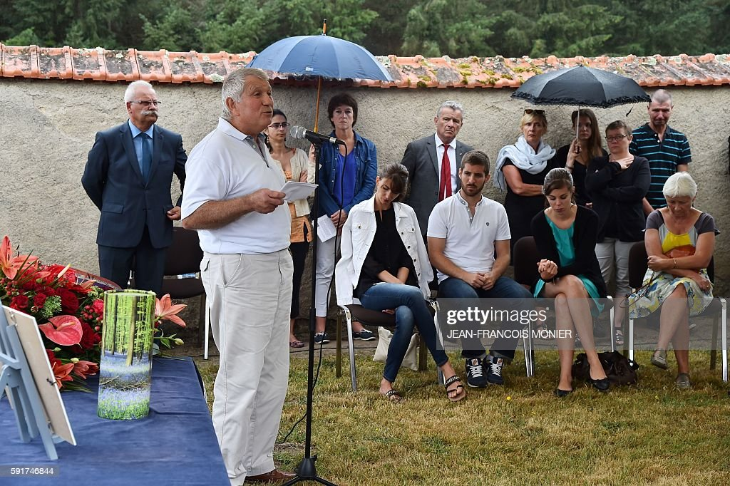 Michel Seguy speaks as he stands next to the urn during the funeral of their father Georges Seguy former secretary general of French major union CGT...