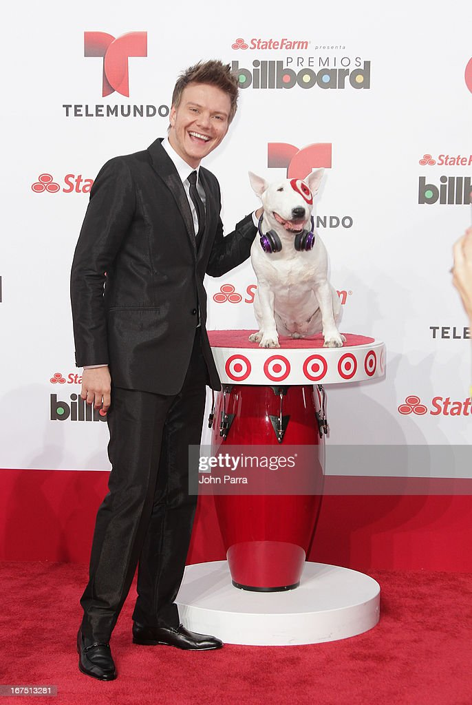 Michel Telo celebrates with Bullseye, Target's Beloved Bull Terrier Mascot, at the 2013 Billboard Latin Music Awards at BankUnited Center on April 25, 2013 in Miami, Florida.