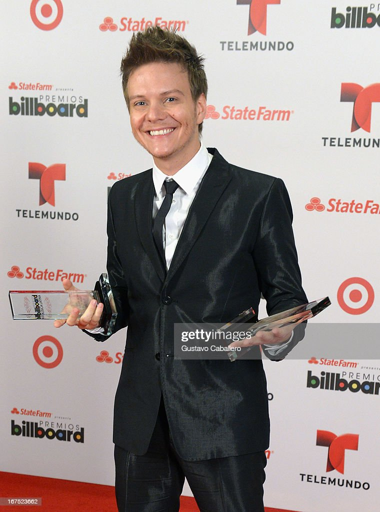 <a gi-track='captionPersonalityLinkClicked' href=/galleries/search?phrase=Michel+Telo&family=editorial&specificpeople=8785378 ng-click='$event.stopPropagation()'>Michel Telo</a> poses backstage at Billboard Latin Music Awards 2013 at Bank United Center on April 25, 2013 in Miami, Florida.