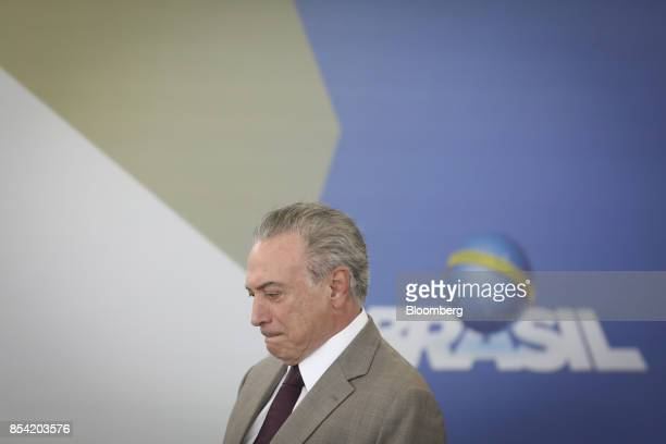 Michel Temer Brazil's president arrives to the launch event of the Progredir program which aims to offer micro credit at the Planalto Palace in...