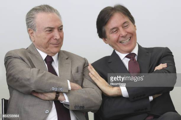 Michel Temer Brazil's president left and Eunicio Oliveira president of Brazil's senate smile during the launch event of the Progredir program which...