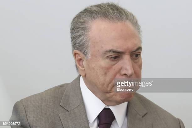 Michel Temer Brazil's president listens during the launch event of the Progredir program which aims to offer micro credit at the Planalto Palace in...