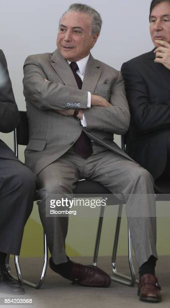 Michel Temer Brazil's president sits during the launch event of the Progredir program which aims to offer micro credit at the Planalto Palace in...