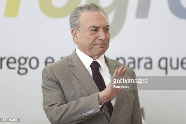 Michel Temer Brazil's president waves to attendees during the launch event of the Progredir program which aims to offer micro credit at the Planalto...