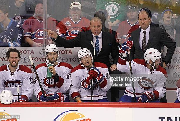 Michel Therrien head coach of the Montreal Canadiens gestures from the bench in third period action in an NHL game against the Winnipeg Jets at the...