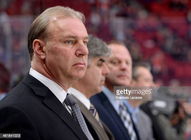 Michel Therrien head coach of the Montreal Canadiens looks on from the bench during the warm up before the game against the Chicago Blackhawks on...