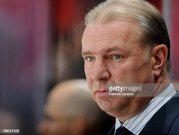 Michel Therrien head coach of the Montreal Canadiens watches his team before the game against the Dallas Stars during the NHL game on October 29 2013...