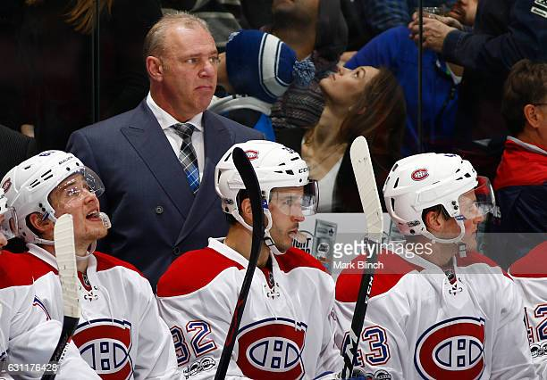 Michel Therrien head coach of the Montreal Canadiens watches the game against the Toronto Maple Leafs during the second period at the Air Canada...