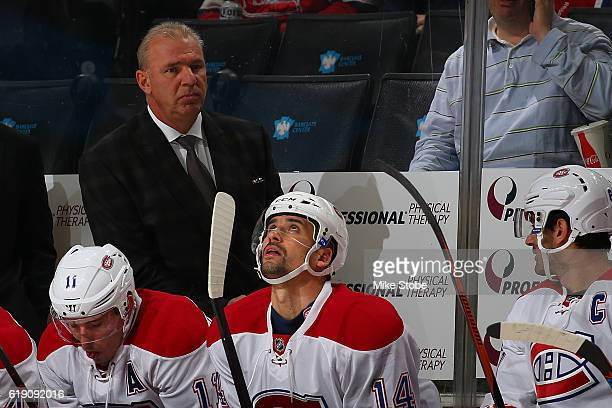 Michel Therrien of the Montreal Canadiens looks on from the bench against the New York Islanders at the Barclays Center on October 26 2016 in...
