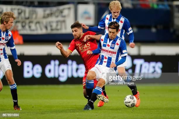 Michel Vlap of SC Heerenveen Alireza Jahanbakhsh of AZ Alkmaar Yuki Kobayashi of SC Heerenveen during the Dutch Eredivisie match between SC...