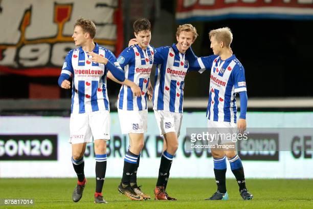 Michel Vlap of SC Heerenveen celebrates 02 with Kik Pierie of SC Heerenveen Yuki Kobayashi of SC Heerenveen during the Dutch Eredivisie match between...