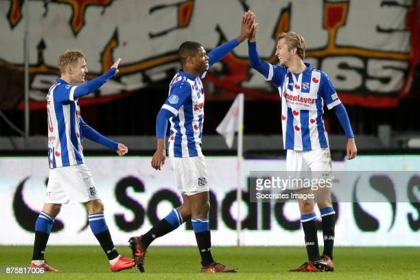 Michel Vlap of SC Heerenveen celebrates 02 with Martin Odegaard of SC Heerenveen Denzel Dumfries of SC Heerenveen during the Dutch Eredivisie match...