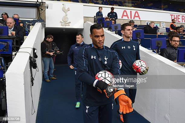 Michel Vorm and Hugo Lloris of Tottenham Hotspur walk into the pitch for the warmup prior to the Barclays Premier League match between Tottenham...