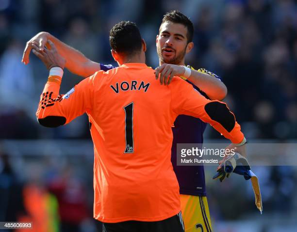 Michel Vorm and Jordi Amat of Swansea City celebrates their teams late winner at the final whistle during the Barclays Premier League match between...