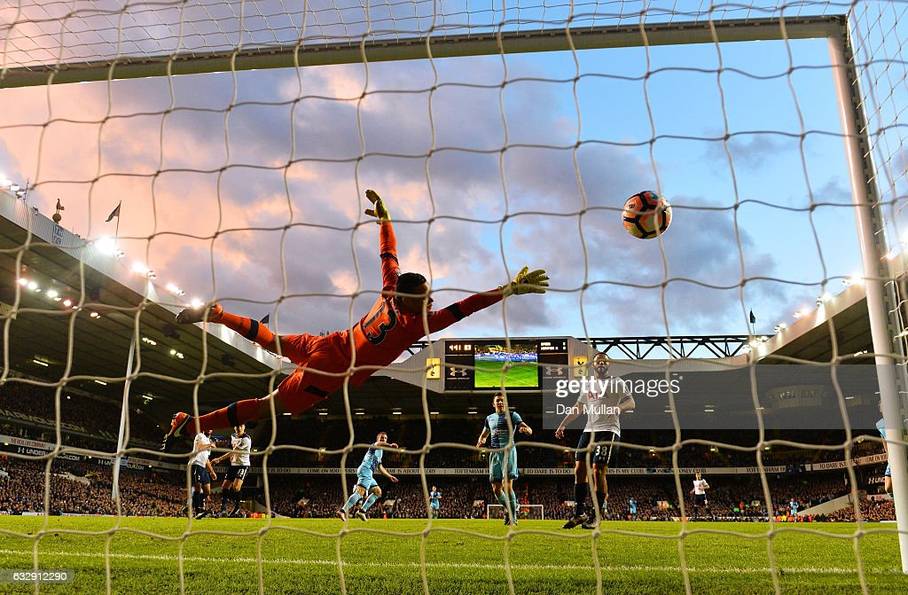 Michel Vorm of Tottenham Hotspur dives as Gary Thompson of Wycombe scores his sides hird goal during the Emirates FA Cup Fourth Round match between Tottenham Hotspur and Wycombe Wanderers at White Hart Lane on January 28, 2017 in London, England.