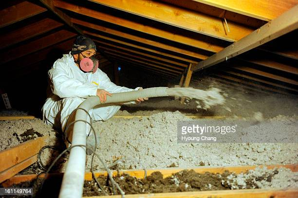 Michel Welch of Longs Peak Energy Conservation is adding insulation at the attic of Cindy Louy home in Broomfield on Tuesday The house gets...