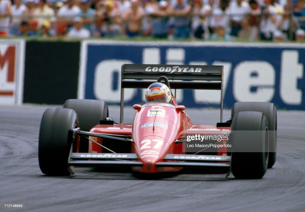 Michele Alboreto of Italy in action, driving a #27 Ferrari F1/87 with a Ferrari 033D 1.5 V6t engine for Team Scuderia Ferrari SpA SEFAC, during the British Grand Prix at Silverstone in England on 12th July 1987. Alboreto would go on to retire from the race during the 52nd lap with suspension problems.