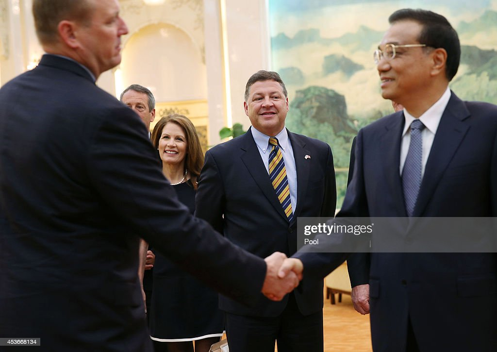 Michele Bachmann (3-L), Congressman Bill Shuster (C), the U.S. Chair of the House Committee on Transportation and Infrastructure and fellow delegates meet with Chinese Premier Li Keqiang (R) at the Great Hall of the People on August 16, 2014 in Beijing, China.