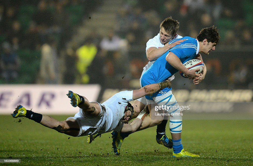 Michele Campagnaro is tackled by Jack Nowell of England during the International match between England U20 and Italy U20 at Franklin's Gardens on March 8, 2013 in Northampton, England.