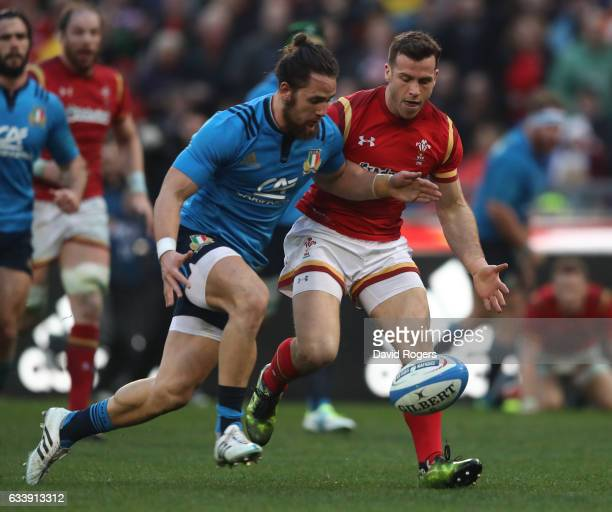 Michele Campagnaro of Italy and Gareth Davies of Wales tussle for the loose ball during the RBS Six Nations match between Italy and Wales at the...
