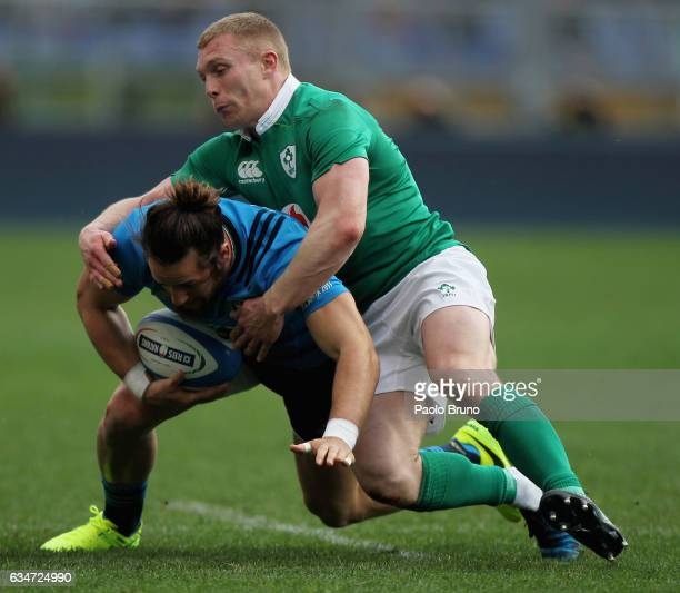 Michele Campagnaro of Italy is tackled by Keith Earls of Ireland during the RBS Six Nations match between Italy and Ireland at Stadio Olimpico on...