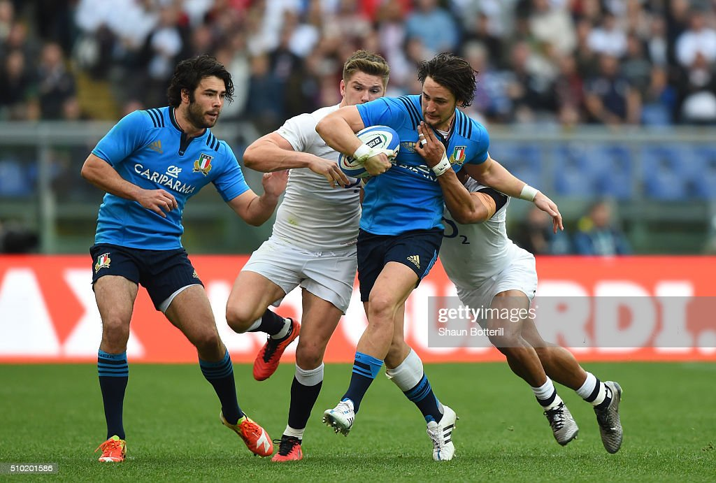 Michele Campagnaro of Italy is tackled by <a gi-track='captionPersonalityLinkClicked' href=/galleries/search?phrase=Owen+Farrell&family=editorial&specificpeople=4809668 ng-click='$event.stopPropagation()'>Owen Farrell</a> and <a gi-track='captionPersonalityLinkClicked' href=/galleries/search?phrase=Jonathan+Joseph+-+Rugby+Player&family=editorial&specificpeople=11460526 ng-click='$event.stopPropagation()'>Jonathan Joseph</a> of England during the RBS Six Nations match between Italy and England at the Stadio Olimpico on February 14, 2016 in Rome, Italy.