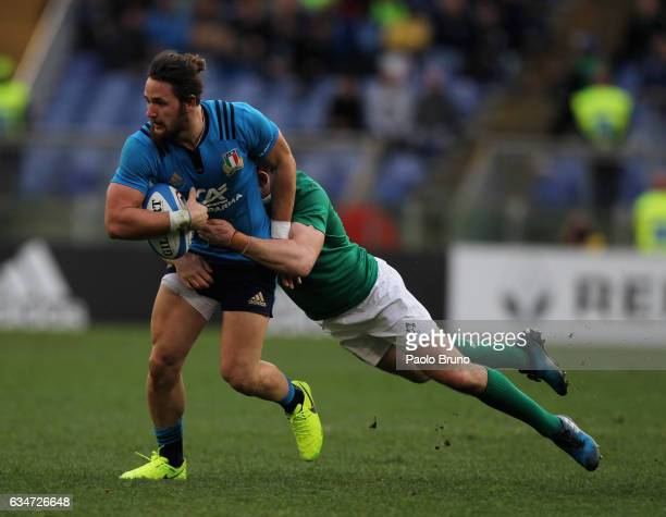 Michele Campagnaro of Italy is tackled by Paddy Jackson of Ireland during the RBS Six Nations match between Italy and Ireland at Stadio Olimpico on...