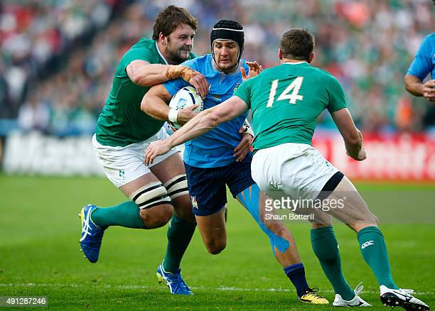 Michele Campagnaro of Italy is tackled by Tommy Bowe and Iain Henderson of Ireland during the 2015 Rugby World Cup Pool D match between Ireland and...