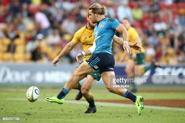 Michele Campagnaro of Italy kicks ahead during the International Test match between the Australian Wallabies and Italy at Suncorp Stadium on June 24...