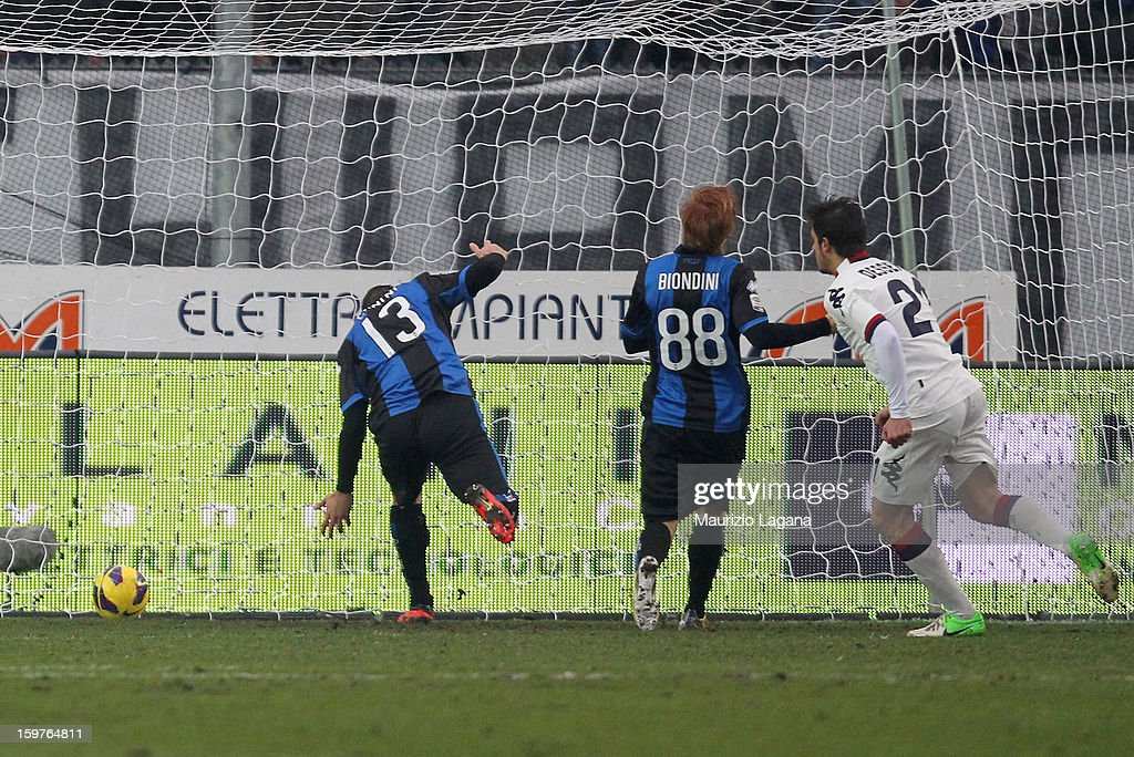 Michele Canini (L) of Atalanta scores an own goal during the Serie A match between Atalanta BC and Cagliari Calcio at Stadio Atleti Azzurri d'Italia on January 20, 2013 in Bergamo, Italy.