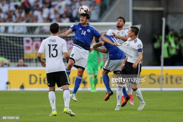 Michele Cervellini of San Marino Danilo Rinaldi of San Marino and Emre Can of Germany Julian Draxler of Germany battle for the ball during the FIFA...