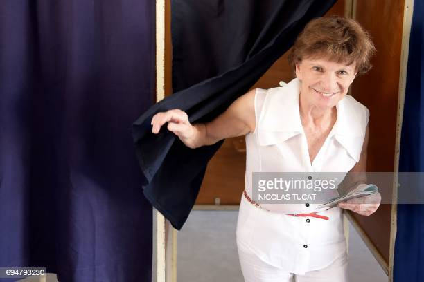 Michele Delaunay Socialist Party candidate in the 2nd constituency of Gironde leaves a voting booth at a polling station in Bordeaux southwestern...