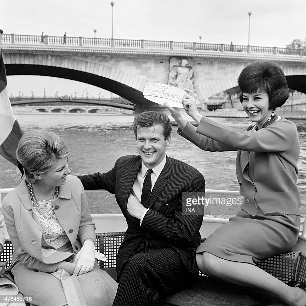 Michele Demai and Denise Fabre by boat fly with Roger Moore hero of the television serial ''The saint''