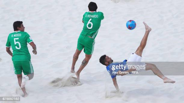 Michele di Palma of Italy attempts a bicycle kick next to Gonzalo Pichardo and Benjamin Mosco of Mexico during the FIFA Beach Soccer World Cup...