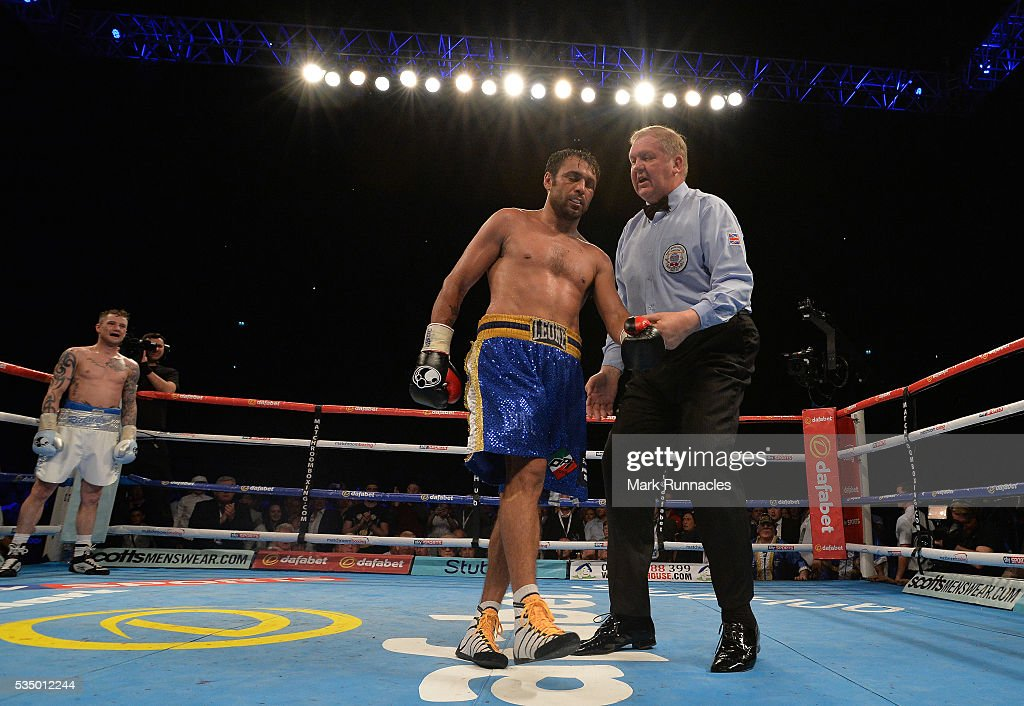 Michele Di Rocco of Italy lies on the canvas after being counted out of his match up with Ricky Burn, Leaving Ricky Burns as the WBA world super-lightweight title fight at The SSE Hydro on May 28, 2016 in Glasgow, Scotland.
