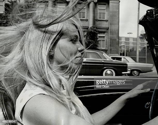 Michele Hollingworth demonstrates how long blowing hair can block a driver's vision