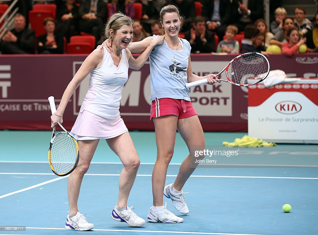 <a gi-track='captionPersonalityLinkClicked' href=/galleries/search?phrase=Michele+Laroque&family=editorial&specificpeople=593269 ng-click='$event.stopPropagation()'>Michele Laroque</a> and Alize Cornet in action during the Amelie Mauresmo Tennis Night to benefit the 'Institut Curie' to fight cancer during the 22nd Open GDF Suez held at the Stade de Coubertin on January 28, 2014 in Paris, France.
