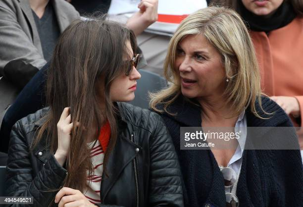 Michele Laroque and her daughter Oriane Deschamps attend Day 5 of the French Open 2014 held at RolandGarros stadium on May 29 2014 in Paris France