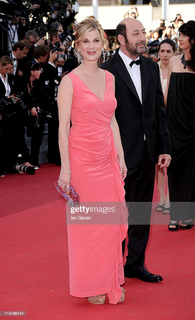 Michele Laroque and Kad Merad (R) attend 'The Artist' premiere at the Palais des Festivals during the 64th Annual Cannes Film Festival on May 15, 2011 in Cannes, France.