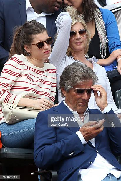 Michele Laroque her daughter Oriane Deschamps below them Dominique Desseigne attend Day 5 of the French Open 2014 held at RolandGarros stadium on May...