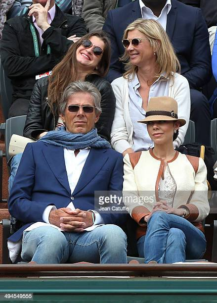 Michele Laroque her daughter Oriane Deschamps below them Dominique Desseigne and Alexandra Cardinale attend Day 5 of the French Open 2014 held at...
