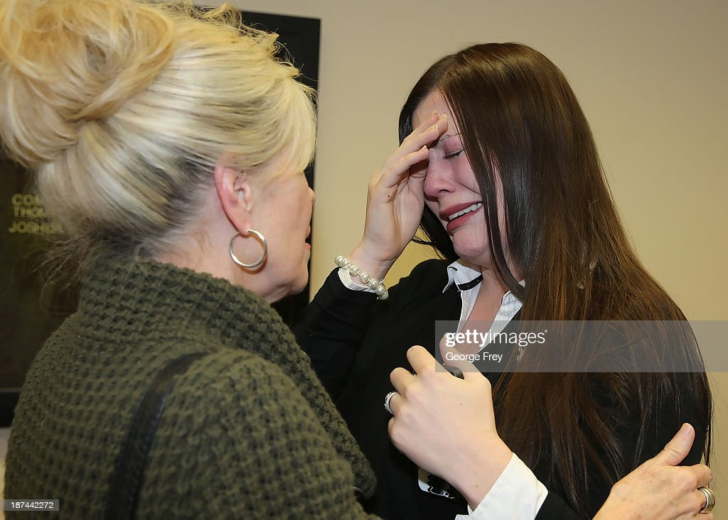 Michele MacNeill's daughter Alexis Somers (R) is comforted by her aunt Susan Hare after her father, Martin MacNeill was found guilty of the murder of his wife Michele MacNeill on November 9, 2013 in Provo, Utah. Martin MacNeill was found guilty of murdering his wife Michele MacNeill in 2007 and will face up to life in prison when he is sentenced in January.