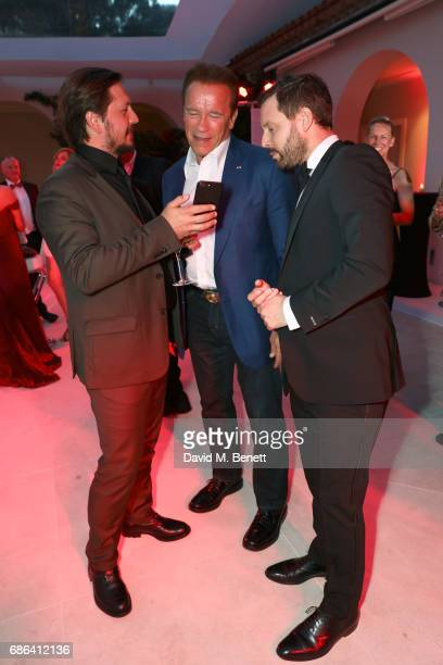 Michele Malenotti Arnold Schwarzenegger and guest attend a dinner hosted by Jamie Reuben Michael Kives with Arnold Schwarzenegger to celebrate...